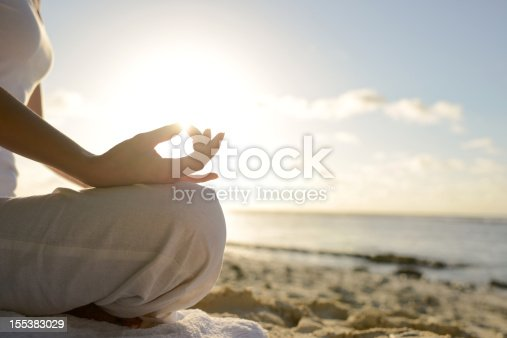 istock Woman Sitting On Beach With Yoga Lotus Position 155383029
