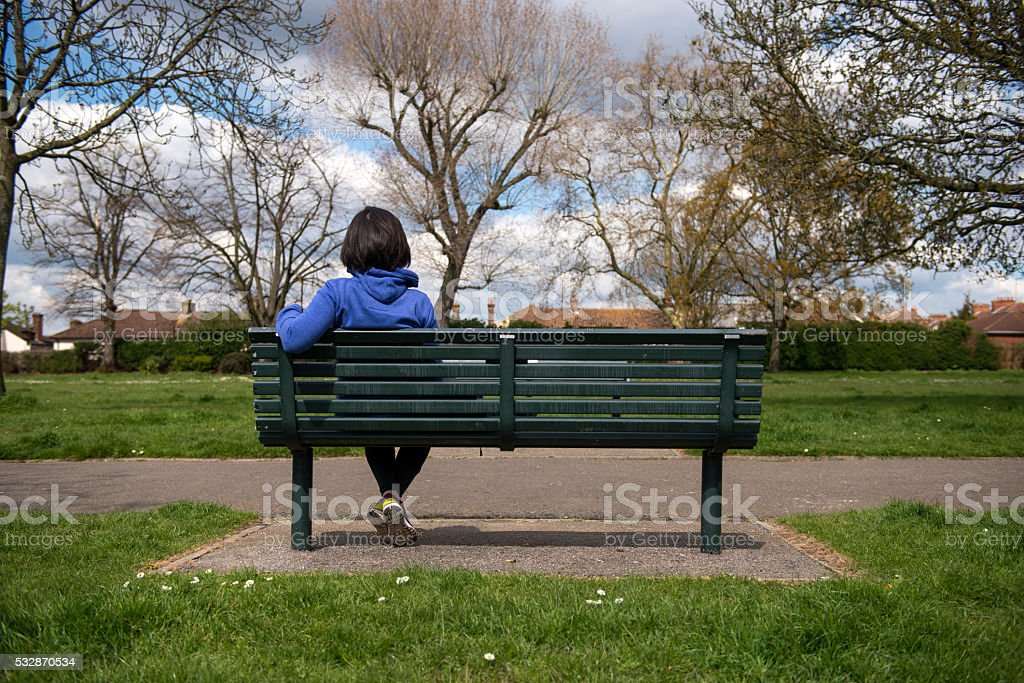 Red Oak Kitchen Table, Woman Sitting On Bench With Back Turned Stock Photo Download Image Now Istock