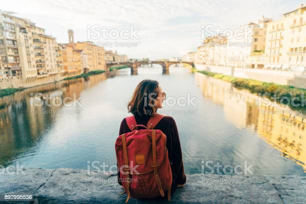Woman sitting on ponte veccio and looking at view picture id892995536?b=1&k=6&m=892995536&s=612x612&h=45shwrvp0841furbr3dcey6hlfg 8hfbjl5jf0z7rok=