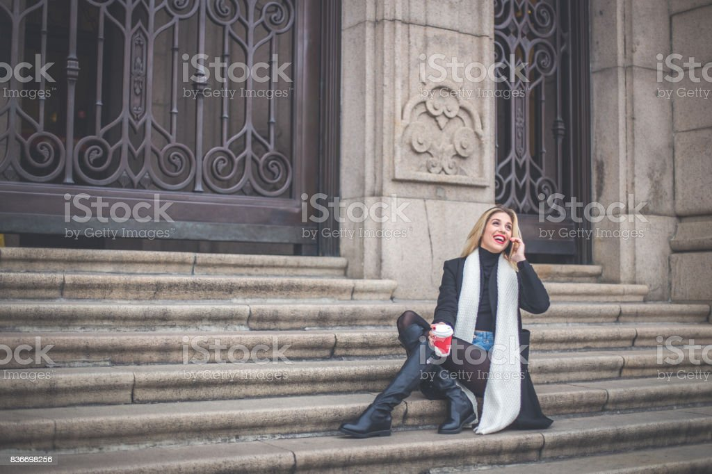 Woman sitting on steps stock photo