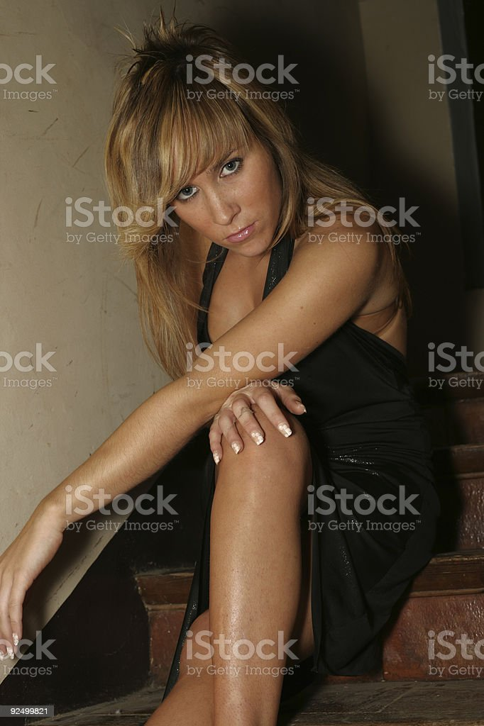 Woman sitting on steps royalty-free stock photo