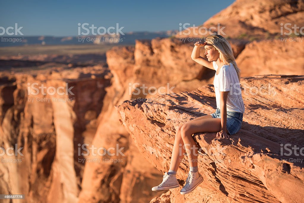 Woman Sitting on the Edge enjoying the view, Horseshoe Bend stock photo