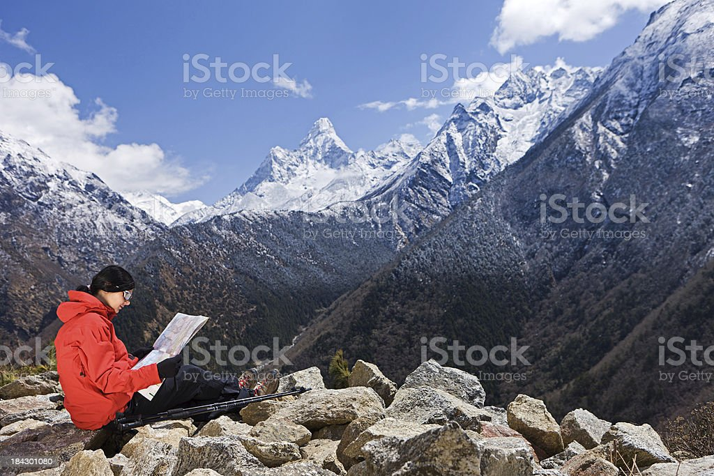 Woman sitting on the rock in Mount Everest National Park royalty-free stock photo
