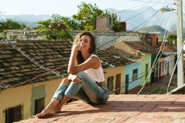 Woman sitting on the roof stock photo