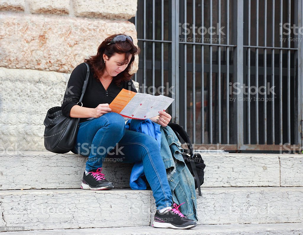 Woman sitting on the stairs stock photo