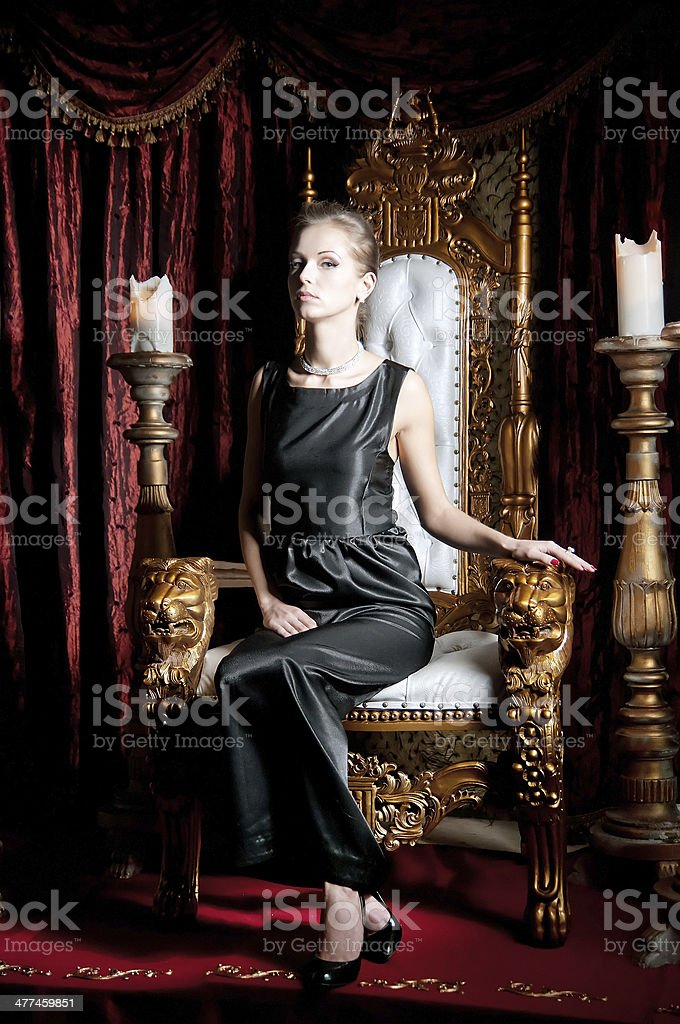 Woman sitting on throne stock photo