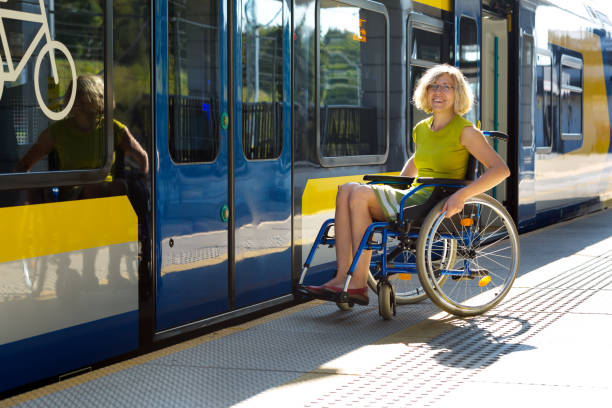woman sitting on wheelchair on a platform stock photo