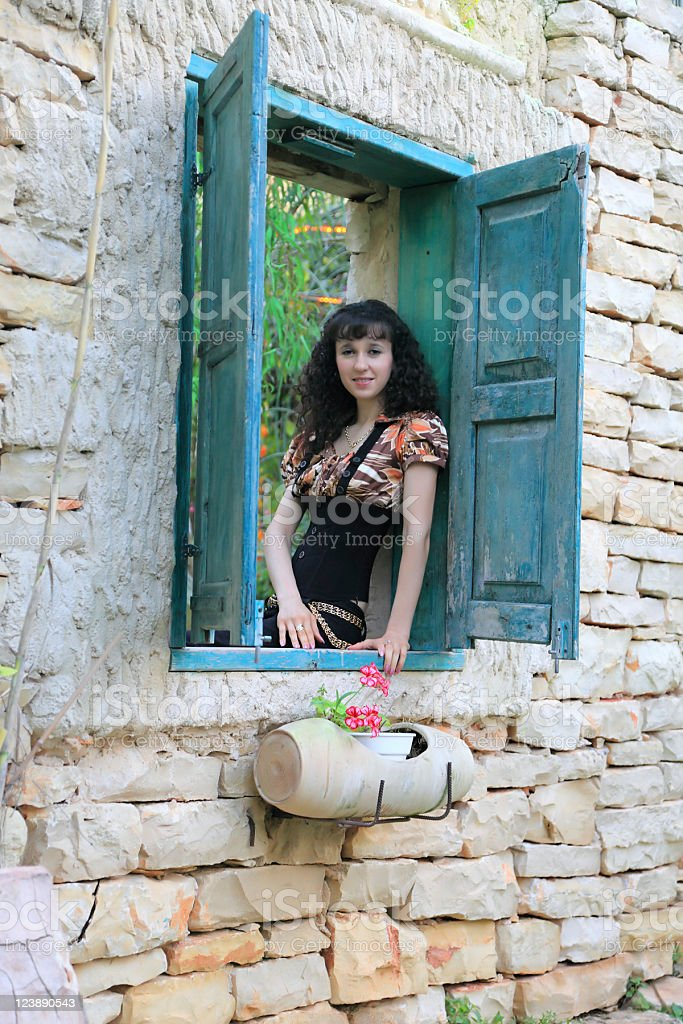 Woman sitting on window royalty-free stock photo