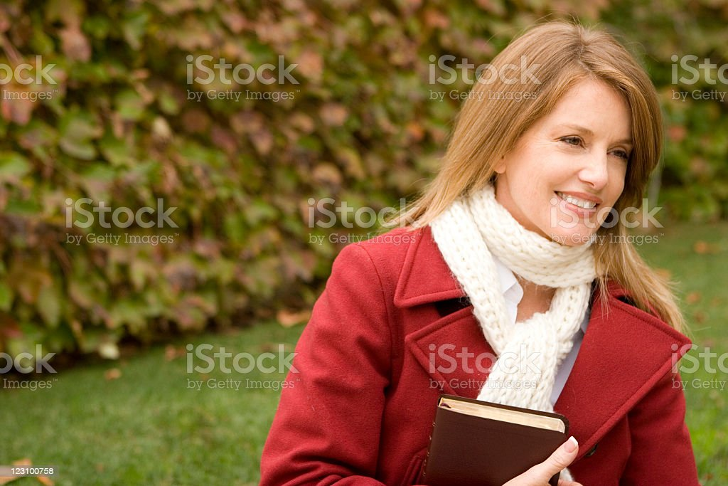 Woman sitting outside royalty-free stock photo