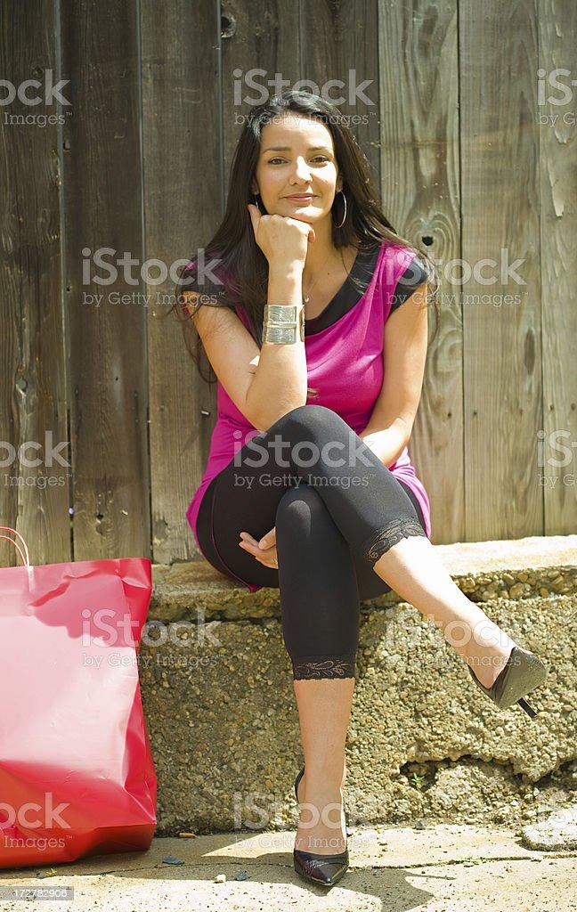 Woman sitting outside royalty-free stock photo