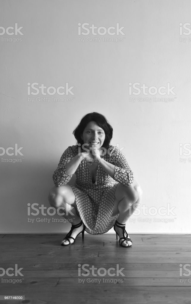 Mature woman squatting