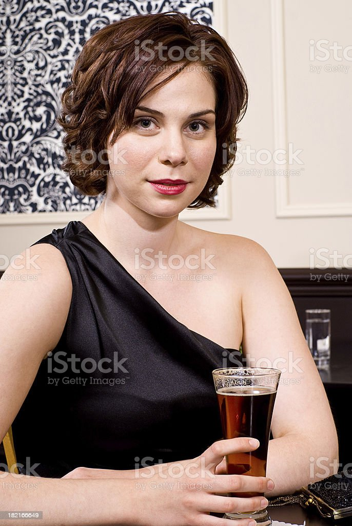 Woman sitting with a Beer royalty-free stock photo