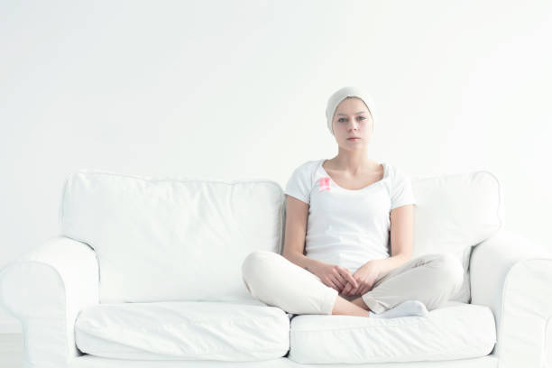 woman sitting with crossed legs - ovarian cancer ribbon stock pictures, royalty-free photos & images