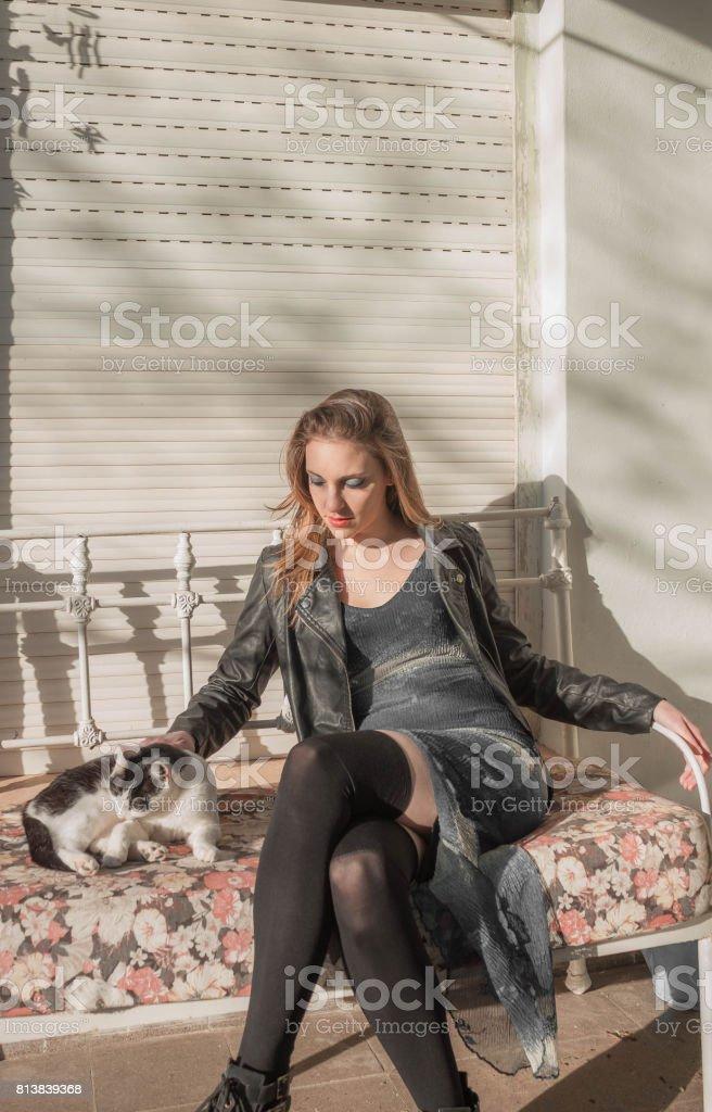Woman sitting with kitten stock photo