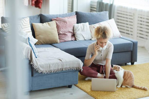 Woman sitting with laptop at home picture id1206638048?b=1&k=6&m=1206638048&s=612x612&w=0&h=icwmogon9wbnhqynxita2fcxs4cfligigqxvfphsh q=