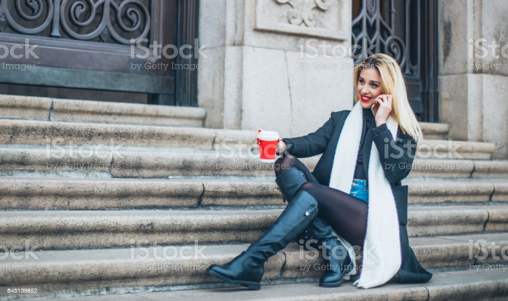 Woman sittting on steps stock photo