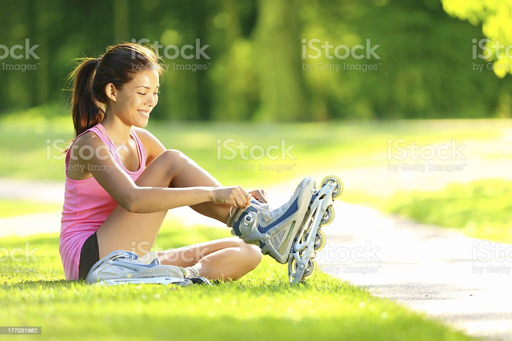 Woman skating in park stock photo