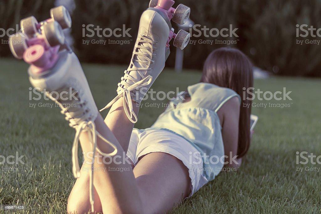 Woman skating in park royalty-free stock photo