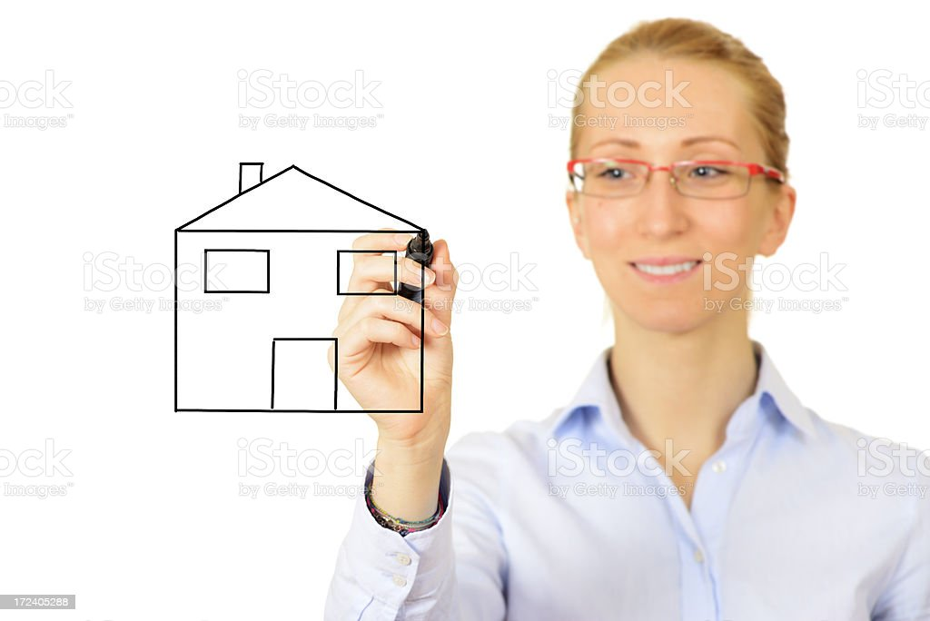 Woman Sketching House on Whiteboard royalty-free stock photo