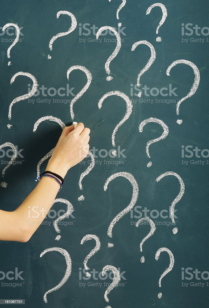 Woman Sketching Question Mark on Blackboard royalty-free stock photo