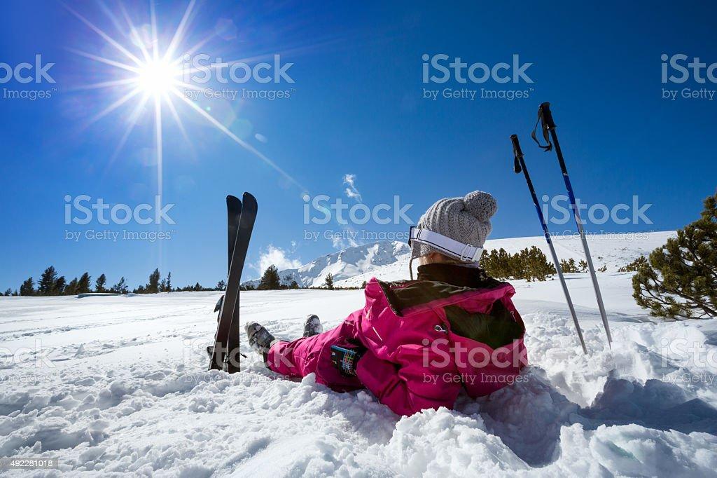 Woman skier enjoy in winter sunny day stock photo