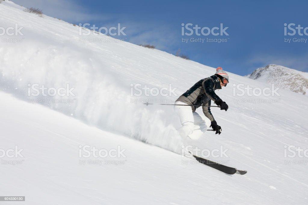 Woman skier skiing at  ski resort Amateur Winter Sports stock photo