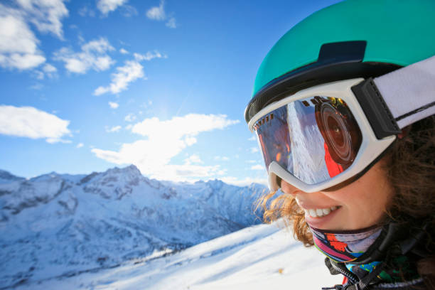 Woman skier skiing at sunny ski resort Amateur Winter Sports On the top Woman skier skiing at sunny ski resort Amateur Winter Sports. High mountain snowy landscape.  Italian Alps mountain of the Dolomites Passo Tonale, Italy. ski goggles stock pictures, royalty-free photos & images