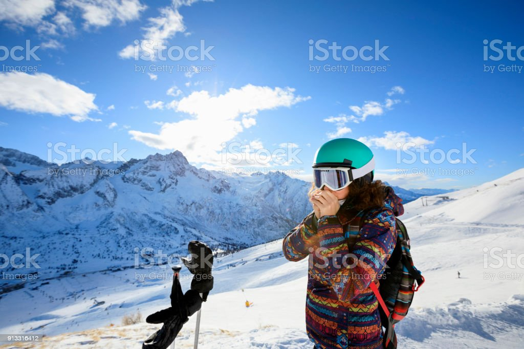 Woman skier skiing at sunny ski resort Amateur Winter Sports On the top stock photo