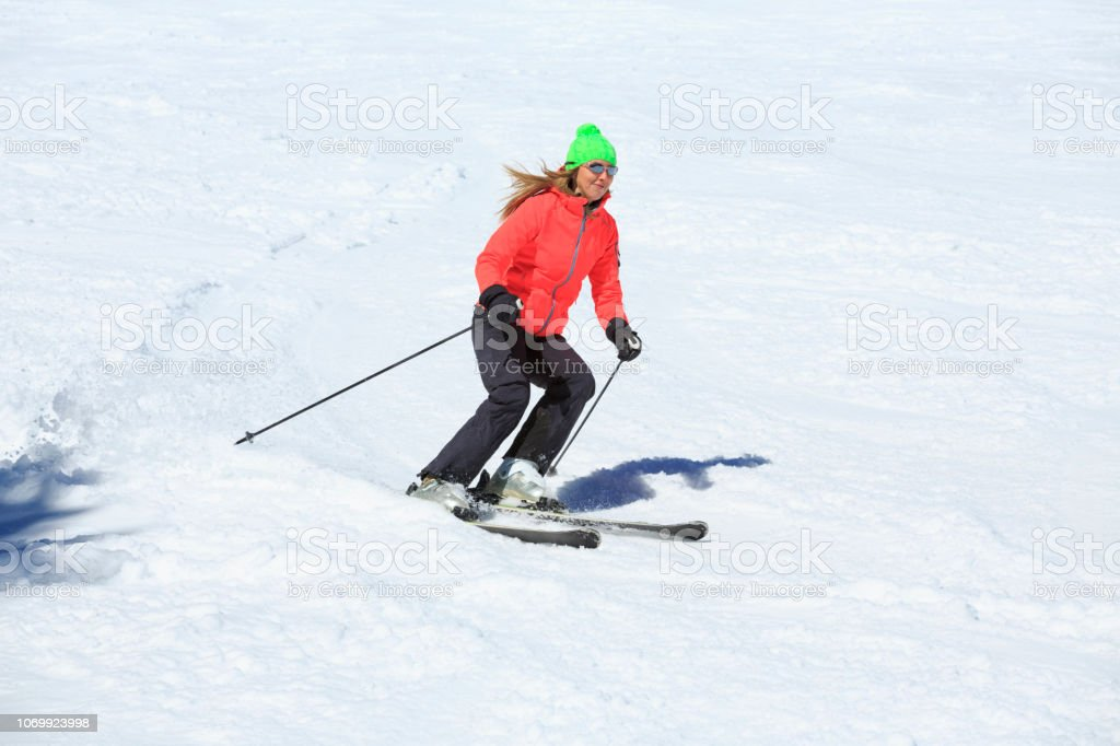 Woman skier skiing at sunny ski resort Amateur Winter Sports. High...