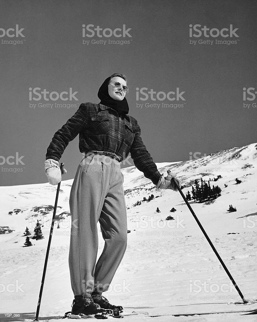 Woman skier standing on slopes royalty-free stock photo
