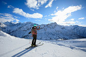 Woman skier using smartphone at sunny ski resort Amateur Winter Sports On the top