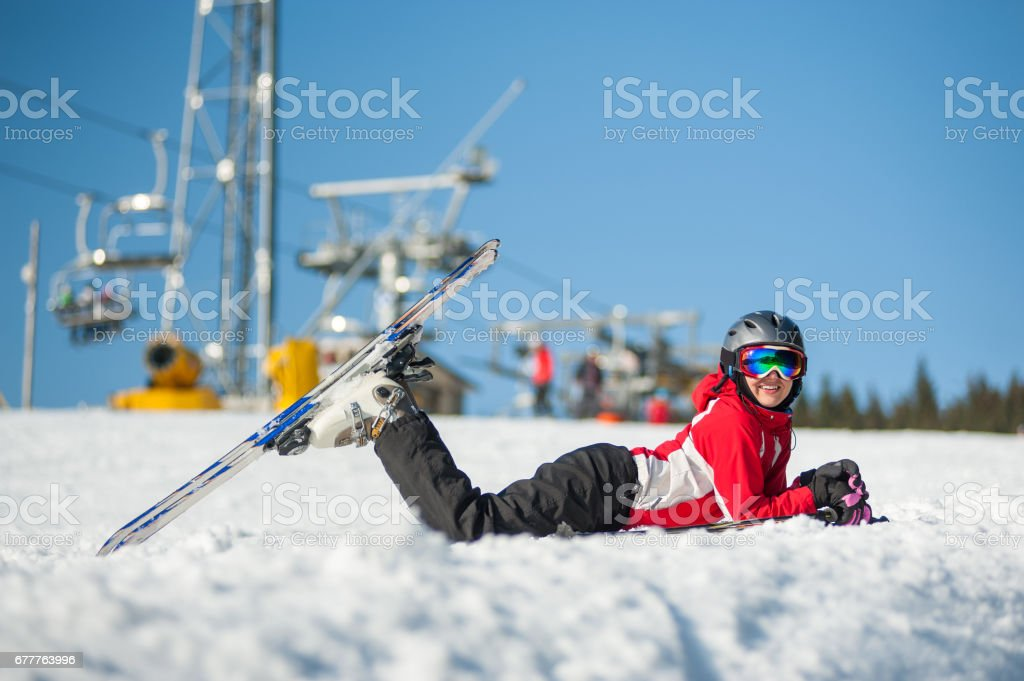 Woman skier with ski at winer resort in sunny day royalty-free stock photo