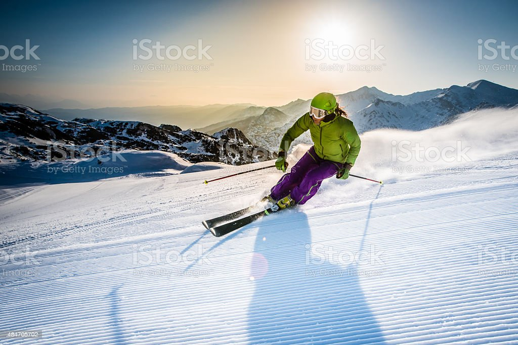 Woman skiing downhill stock photo