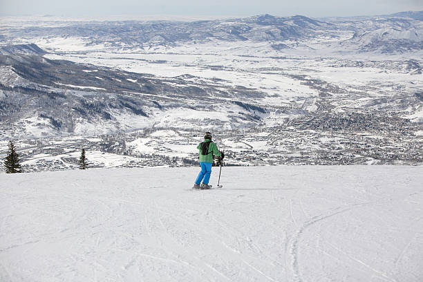 woman skiing high over Steamboat Springs, Colorado