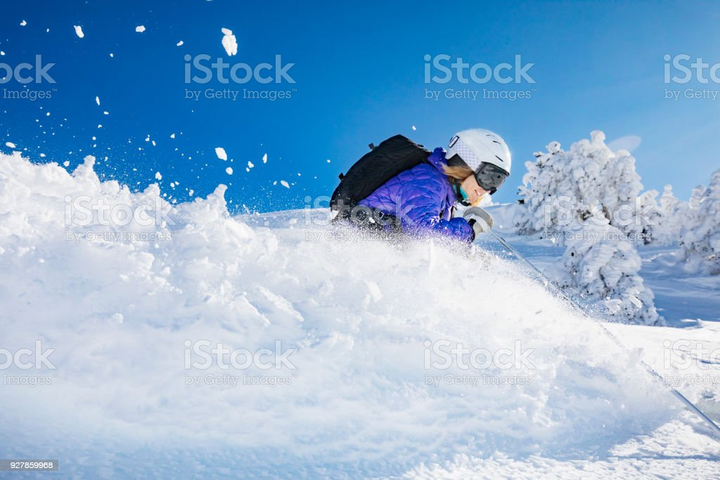 Woman skiing in powder snow