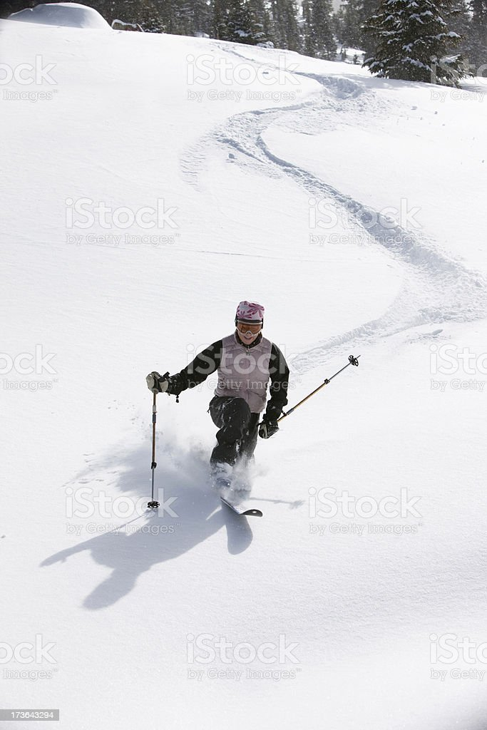 Woman skiing powder royalty-free stock photo