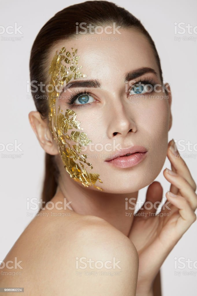 Woman Skin Care Female With Gold Mask Touching Facial Skin Stock Photo Download Image Now Istock