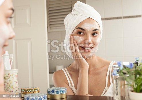 istock woman skincare at the bathroom 1011264316