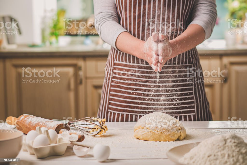 Woman slap his hands above dough closeup. Baker finishing his bakery, shake flour from his hands, free space for text - fotografia de stock