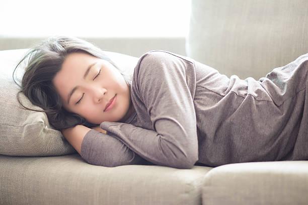 Woman Sleep on Sofa stock photo