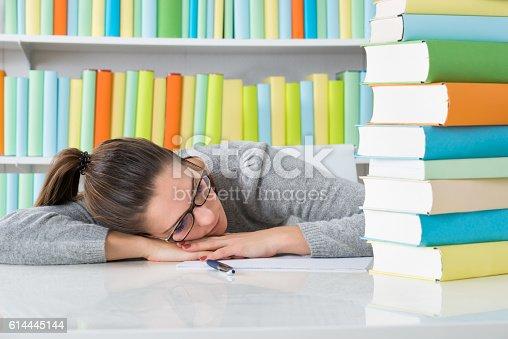istock Woman Sleeping At Desk 614445144