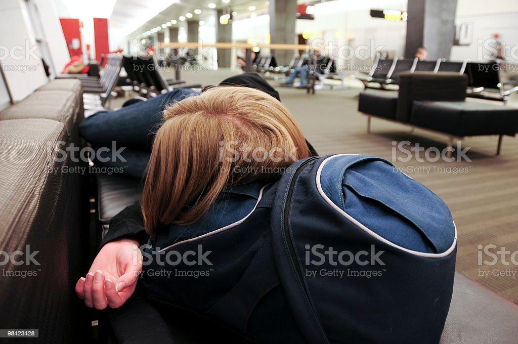 Woman Sleeping at the Airport royalty-free stock photo