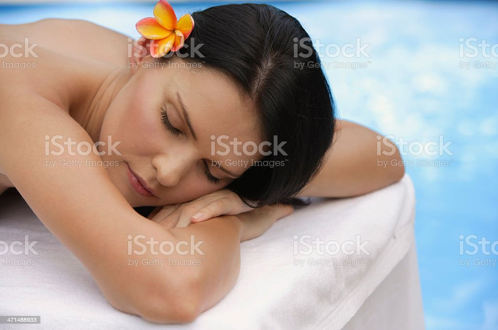 woman sleeping by pool royalty-free stock photo