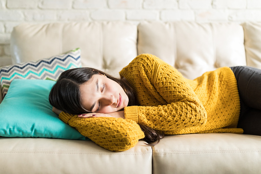 Beautiful woman taking break for short sleep in middle of day at home