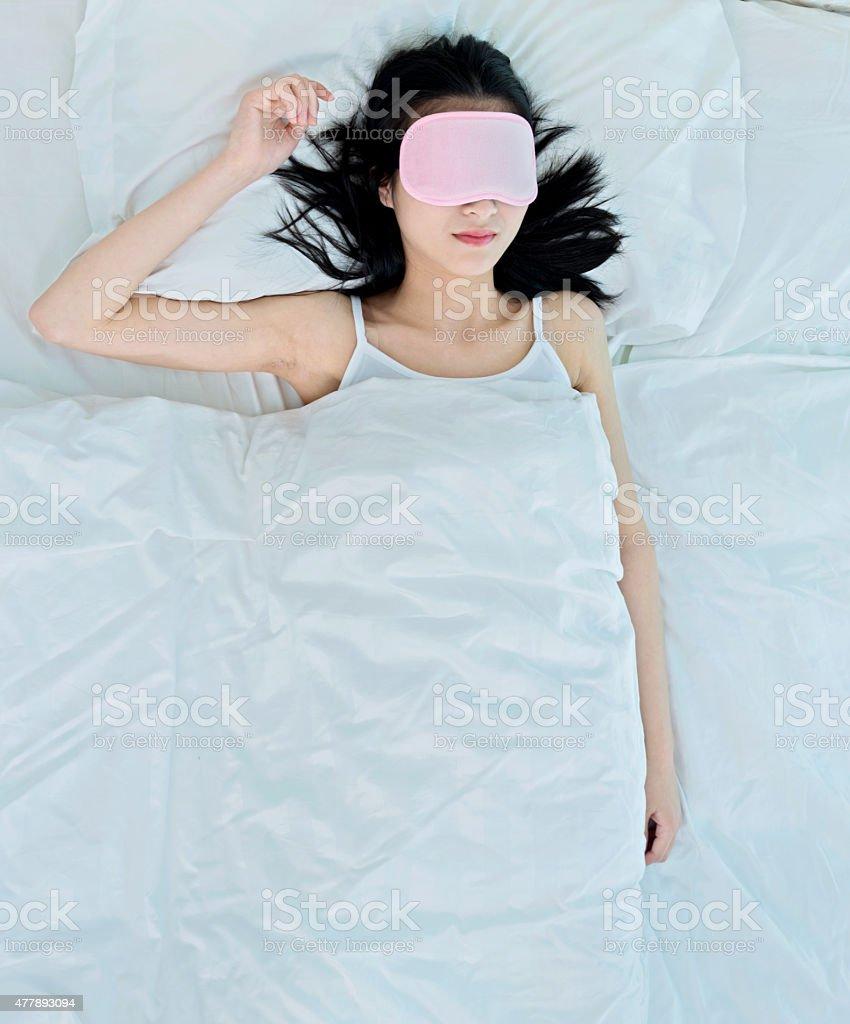 Young attractive woman sleeping in sleep mask