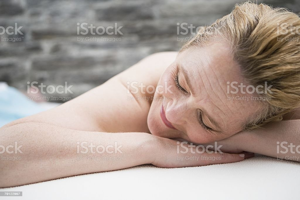 Woman sleeping on a treatment couch 免版稅 stock photo