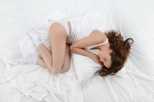 woman sleeping on the bed stock photo