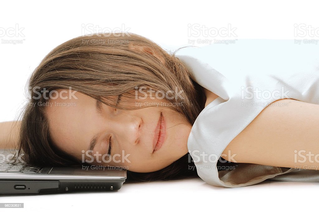 Woman sleeping on the laptop royalty-free stock photo