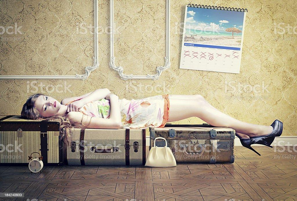 woman, sleeping on the luggage royalty-free stock photo