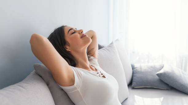 woman sleeping on vacations in an apartment - breathing exercise stock pictures, royalty-free photos & images